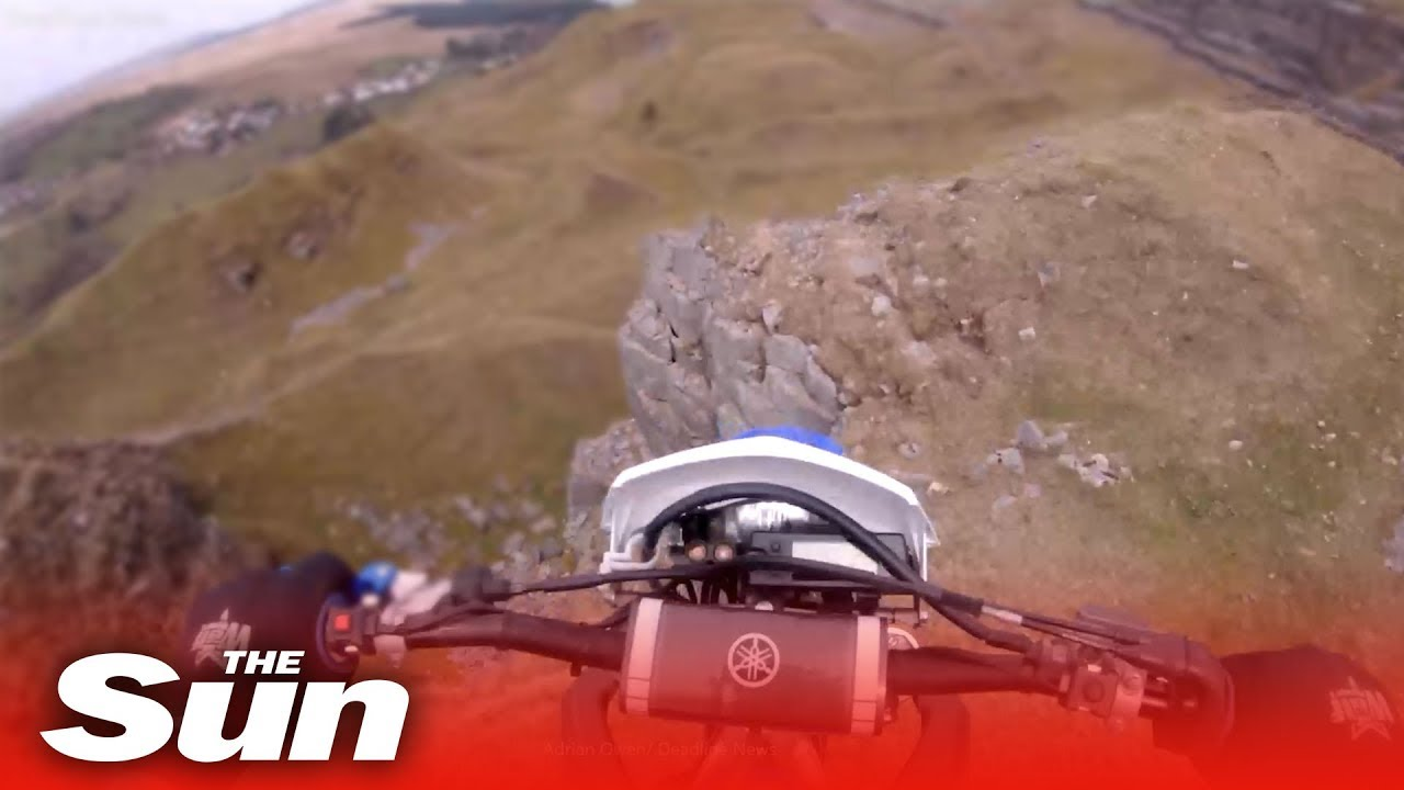 Dirt biker rides off 40ft cliff and survives (Wales)