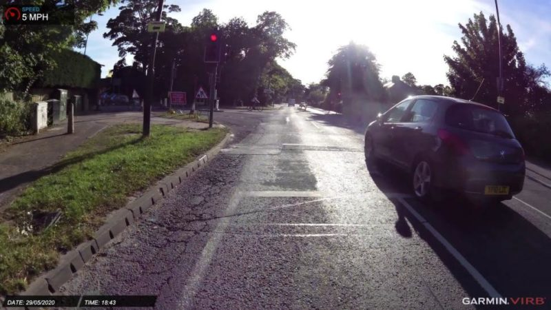 Near Miss of the Day 417: Van driver makes close pass on tandem cyclists – then jumps red light