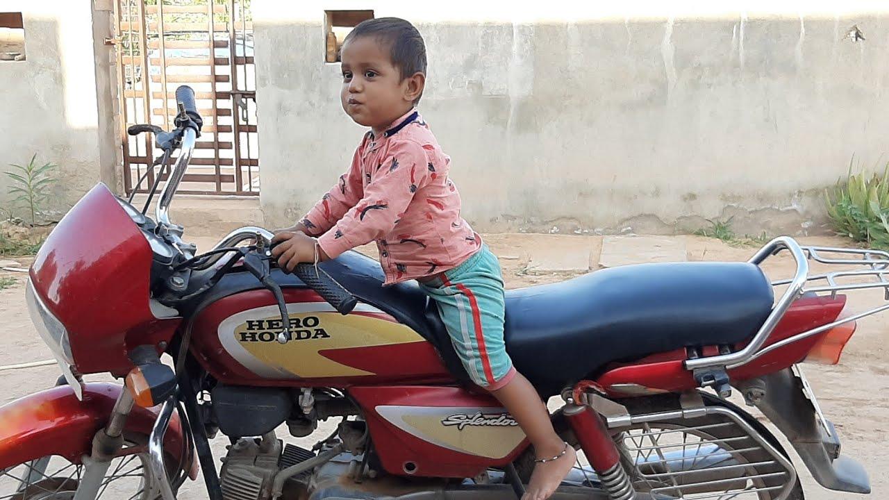 Small boy riding a bike