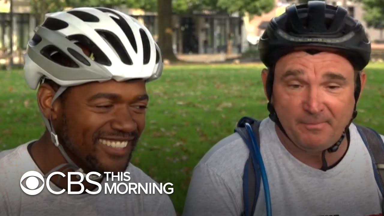 2 men with different backgrounds and political beliefs bike across America to show unity