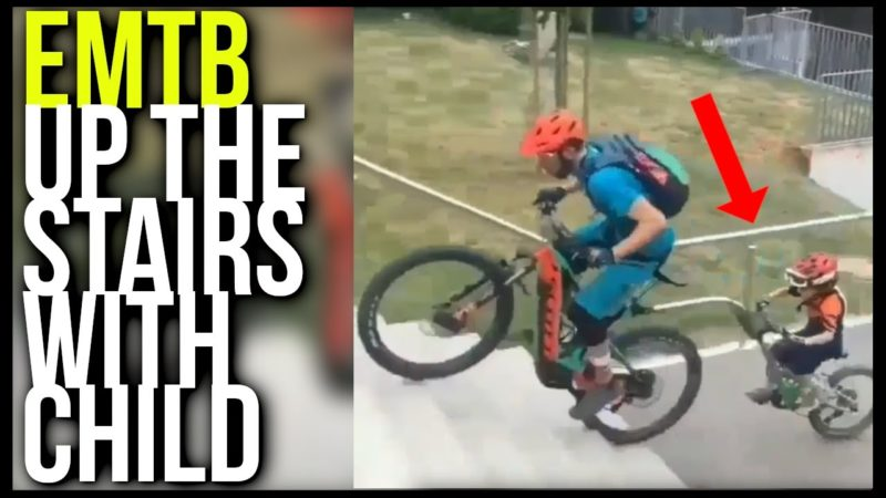 EMTB Father bikes up the stairs with son in back | EMTB 2021 | EMTB child trailer