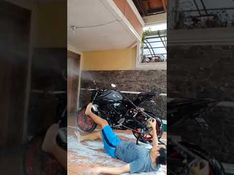 Guy Slips In Water Puddle While Washing Bike With Hose – 1154440