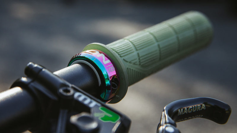 Ergon slides colorful new Oil Slick lock ring onto your grips