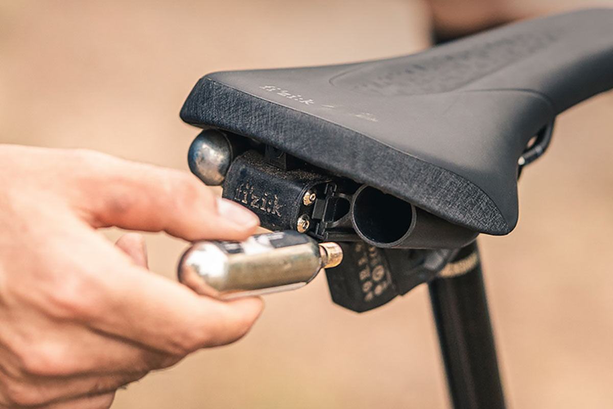 Fizik Alpaca Tool Carrier hides tool, CO2s under their saddles w/o limiting dropper posts