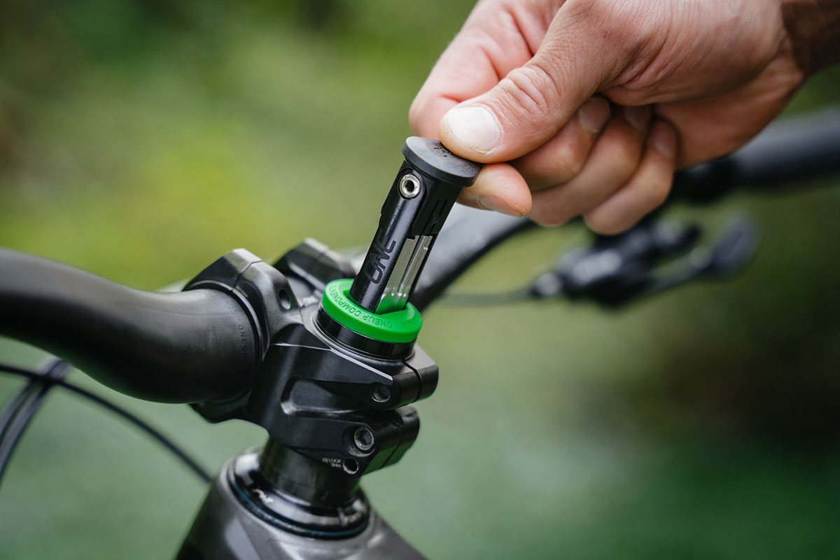 OneUp EDC Lite drops 9 function multi-tool into your steerer tube for just 75g