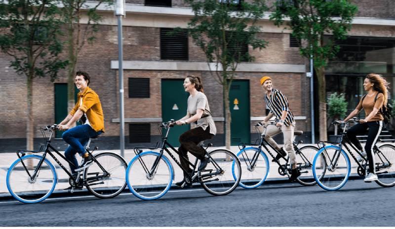 The Blue-Wheeled Bike Leasing Trend Taking Over Europe