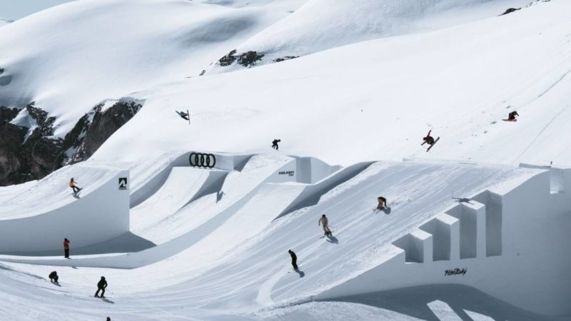 Watch Skiers Form Massive 'Ski Train' in Swiss Alps