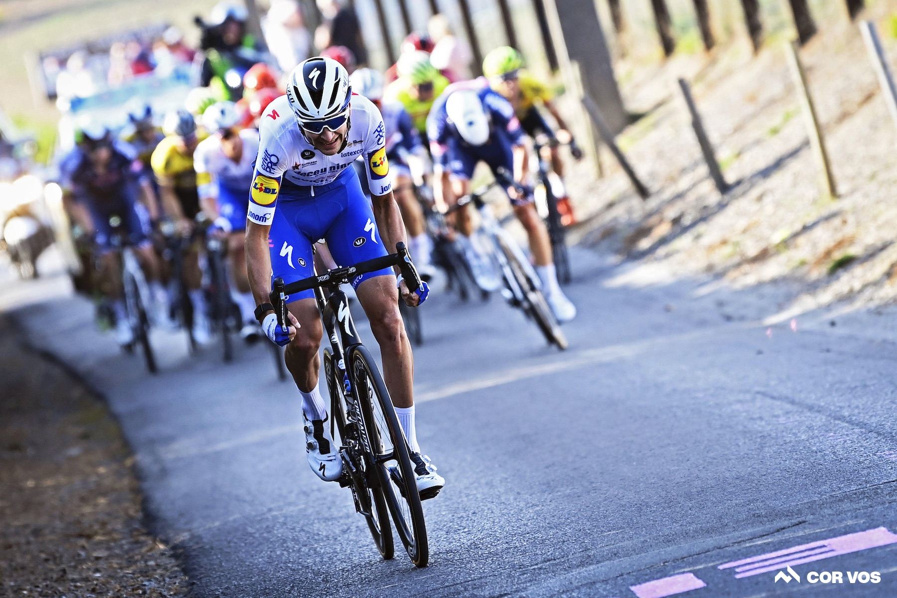 Team car driver hits Pieter Serry from behind