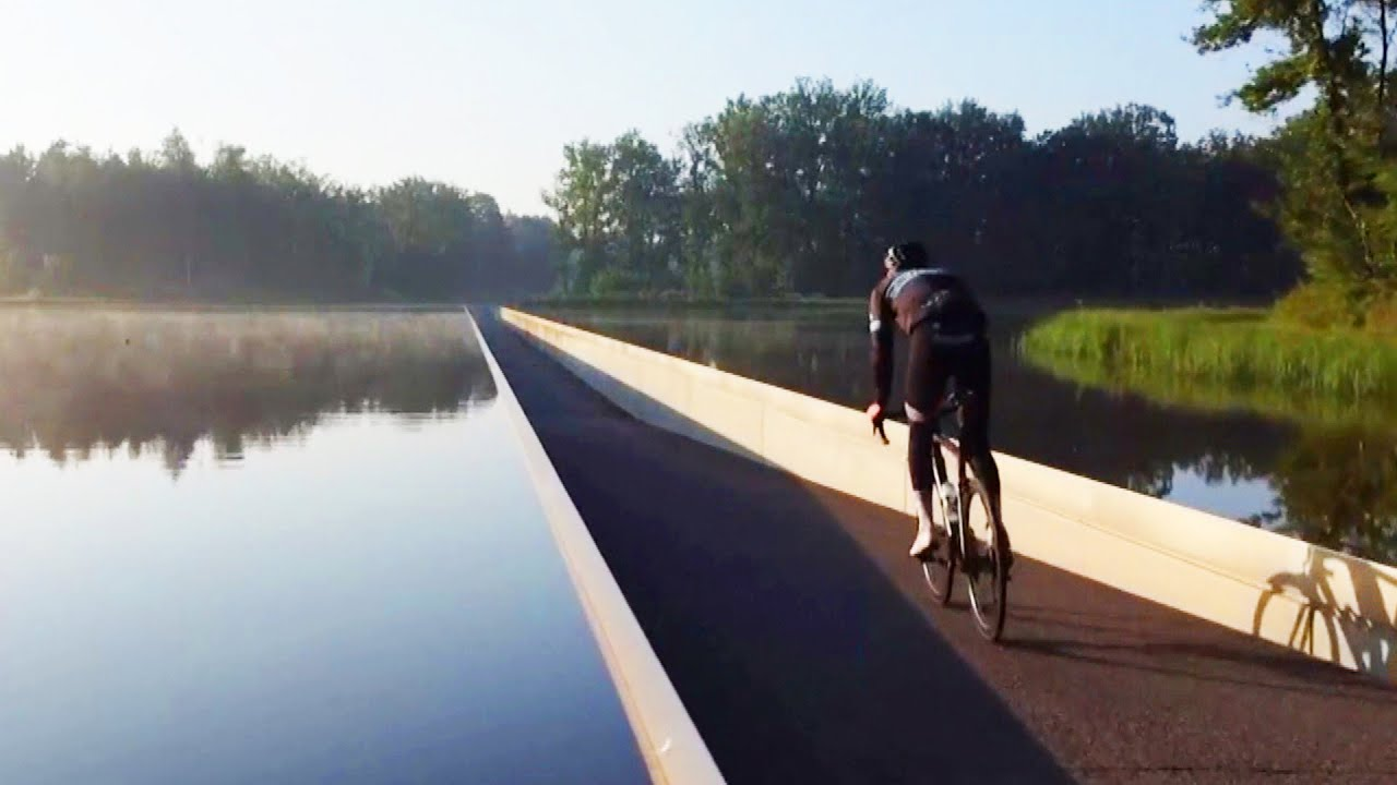 Cyclists Bike Through Water in This Belgian Lake